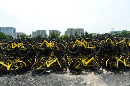"""In June 4, 2018, a stack of shared bicycles was filmed at an abandoned construction site in Hangzhou.Recently, on the site of a abandoned nearly 10000 square meters in the north of Hangzhou,Jiangsu province,China,more than 5 million shared bicycles are stacked in a double double form, like the """"Yellow Sea"""", which is generally very spectacular. Originally, these shared bicycles were stacked together from the reduction of the main urban areas of Hangzhou, and after being overhauled, they will be sent to nearby towns for use. (Photo credit should read Long Wei / Barcroft Media via Getty Images)"""