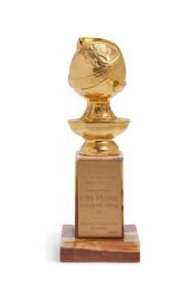 """O Globo de Ouro de melhor ator que recebeu pelo filme """"Bom Dia, Vietname"""" (1987). Foto: Sotheby's New York"""